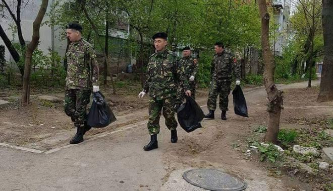 IN CE TARA TRAIM? Militarii adună gunoaiele iar asistaţii social trândăvesc în cârciumi şi puşcăriaşii domnesc în închisori!